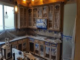 should i spray paint kitchen cabinets how to mask wall cabinets for spray painting dengarden