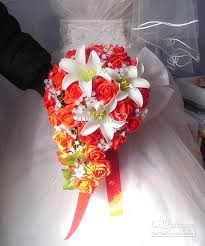 wedding flowers ni roses with 3 flowers with waterfall type holds