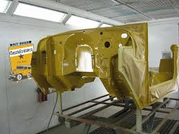 toyota landcruiser fj40 bj42 in the paint booth mustard yellow