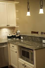 Kitchen Design With Granite Countertops by Cmh Builders Antique White Cabinets With Built In Microwave
