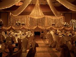 gossamer and white lights backdrop for head table wedding
