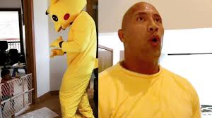 pikachu costume the rock dances to juju on that beat in pikachu costume