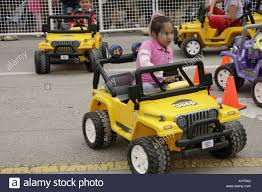electric jeep coral gables yellow jeep child size electric car drive stock