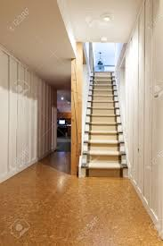 stairway to finished basement in home interior with wood paneling