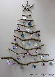 our wall hung stick xmas tree with the kids tinfoil baubles