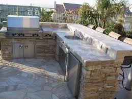 create a backyard oasis with bbq islands u0026 light heaters
