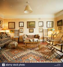 oriental carpet in traditional livingroom with pictures stock