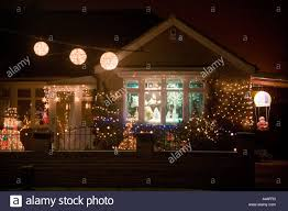 Christmas Decorations Lights For Outside by Christmas Decorations And Lights Outside A House Uk Stock Photo