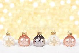 white and gold ornaments in snow stock photo image of