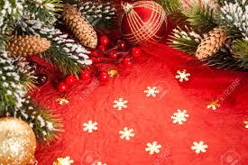 border from christmas tree decorations on red paper stock photo