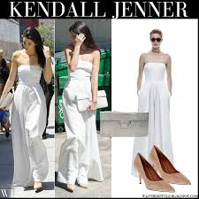 kendall jenner jumpsuit kendall jenner in white strapless solace jumpsuit with croc