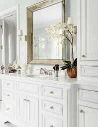 beautiful bathroom features gray his and hers vanities topped with