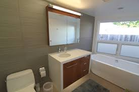 white ceramic bathtub cream granite floor with grey mat grey
