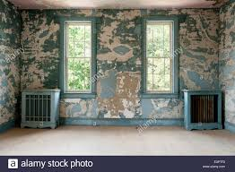 pair of distressed blue radiator covers in room with extremely