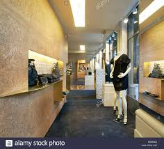 stella mccartney store interior with wooden wall stock photo
