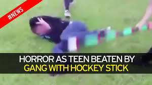 gang of kids attack teenage boy with hockey sticks leaving him