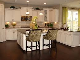 painted white kitchen cabinets two wooden bar stool on the wooden