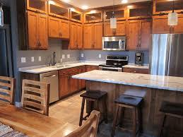 kitchen rustic alder cabinets snowflake granite my lake home