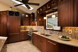 orange kitchen cabinet design with backsplash and pendant lamps