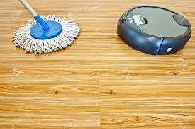 modern floor washing with traditional mop on laminate floor
