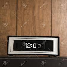 retro wood paneling retro clock set for 12 00 against wood paneling stock photo