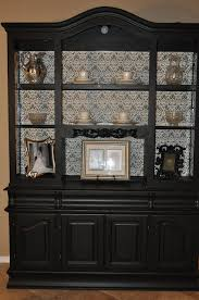 i think i will paint my china cabinet black with a light fabric or