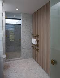 an airy beach house bathroom fulfills its design goals beach bath