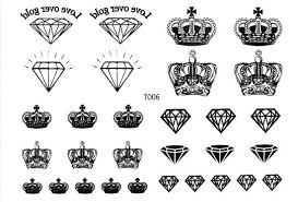 awesome crown tattoos designs