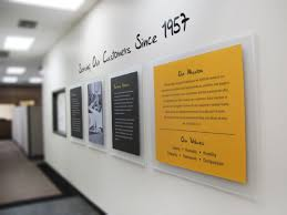 custom design corporate history wall for caterpillar offices