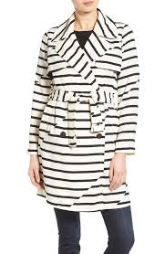 in love with this white and black striped trench coat by madewell