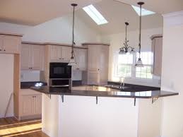 black island and backsplash 3 large kitchen skylights 3 wooden