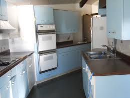 Robert And Caroline S Mid Century Home With Dreamy St by St Charles Metal Cabinets Full Kitchen Blue White In Color Vintage