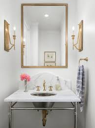 rectangular gold mirror over marble sink vanity transitional