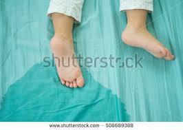 peeing the bed kids feet pee mattresslittle girl feet stock photo 508689388