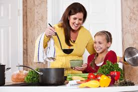 mother serving daughter soup in kitchen mom it forwardmom it forward