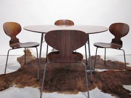 arne jacobsen dining table u0026 4 early three legged ant chairs in