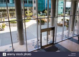 attractive courtyard patio area as seen through the glass entrance