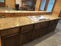 what color cabinets go with venetian gold granite solutions archives granite surfaces of