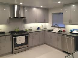 stone countertops flat panel kitchen cabinets lighting flooring