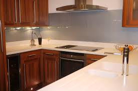 a silver grey glass splashback teamed up with white cabinetry