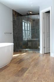 faux wood tile bathroom contemporary with bath tub colonial
