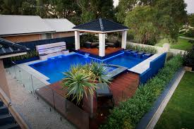 garden covered patio with pool landscaping and waterfall also