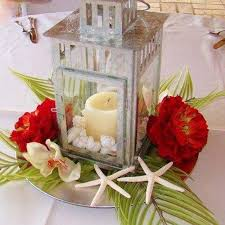 Lanterns With Flowers Centerpieces by Best 25 Tropical Centerpieces Ideas On Pinterest Luau Wedding