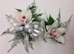 orchid corsage cymbidium orchid corsage and boutonnière centerville florists