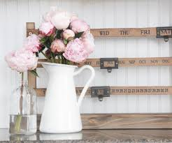 gorgeous peonies in a farmhouse pitcher from ikea the rustic
