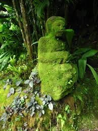 moss covered lady statue como shambala estate bali photo
