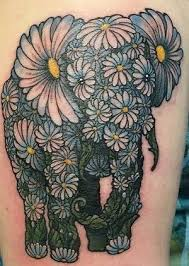 elephant made with daisy flowers tattoo on arm
