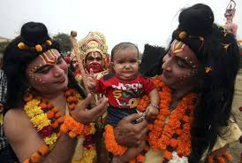 hindu l artists dressed as hindu gods rama r and laxman l give blessings