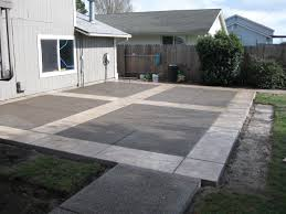 grey stone floor patio and green grass yard also white wooden wall