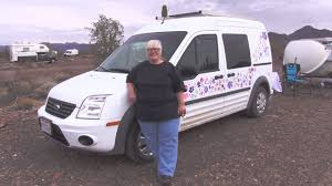 woman living solo in her ford transit connect van